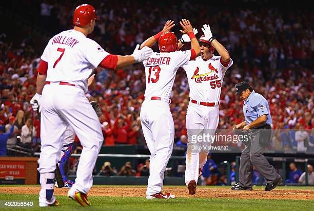 Stephen Piscotty of the St Louis Cardinals celebrates with Matt Carpenter of the St Louis Cardinals after hitting a tworun home run in the eighth...