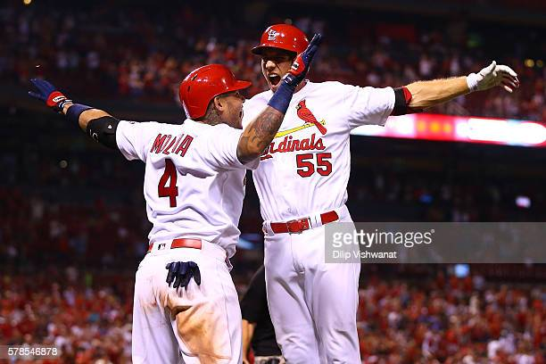 Stephen Piscotty of the St Louis Cardinals celebrates with Yadier Molina of the St Louis Cardinals after hitting a gametying threerun home run...