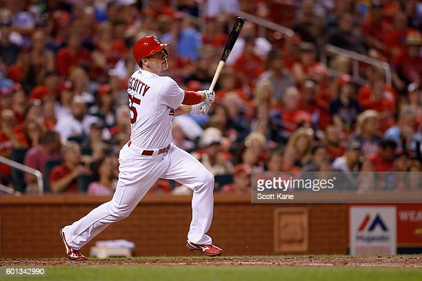 Stephen Piscotty of the St Louis Cardinals follows through after hitting a tworun home run during the third inning of a baseball game against the...