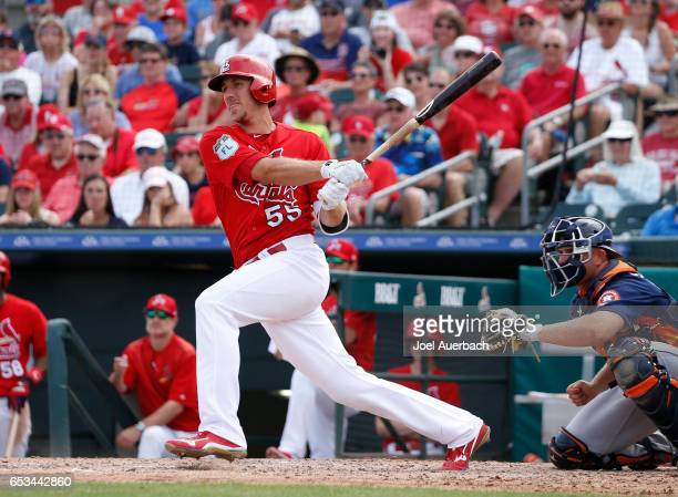 Stephen Piscotty of the St Louis Cardinals hits a double against the Houston Astros in the sixth inning during a spring training game at Roger Dean...