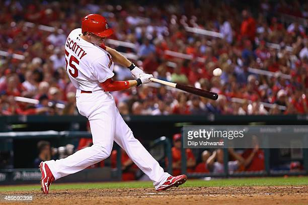 Stephen Piscotty of the St Louis Cardinals hits a single against the Cincinnati Reds in the eighth inning at Busch Stadium on September 22 2015 in St...