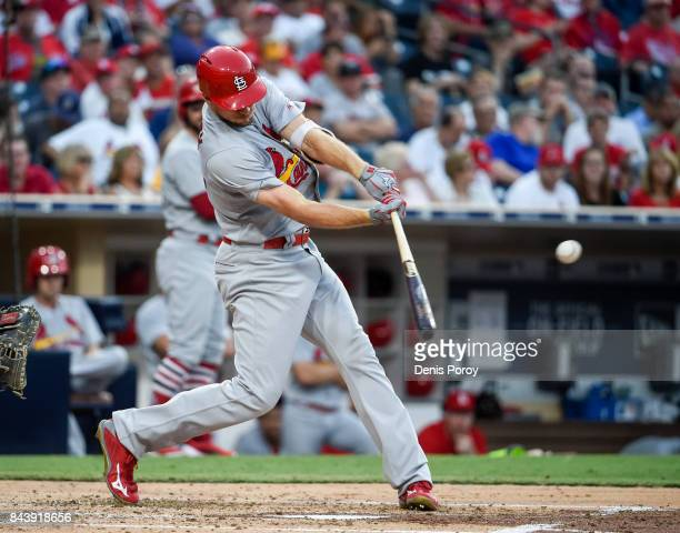 Stephen Piscotty of the St Louis Cardinals hits a single during the second inning of a baseball game against the San Diego Padres at PETCO Park on...