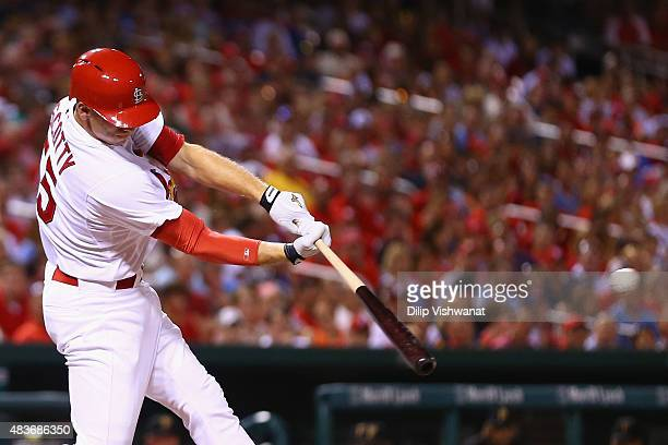 Stephen Piscotty of the St Louis Cardinals hits an RBI single against the Pittsburgh Pirates in the fifth inning at Busch Stadium on August 11 2015...