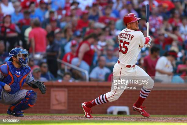 Stephen Piscotty of the St Louis Cardinals hits an RBI single against the New York Mets in the seventh inning at Busch Stadium on July 8 2017 in St...