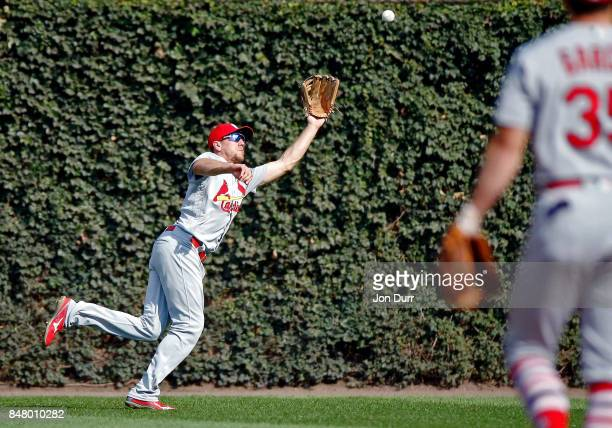 Stephen Piscotty of the St Louis Cardinals makes a catch for an out on a ball hit by Ben Zobrist of the Chicago Cubs during the first inning at...
