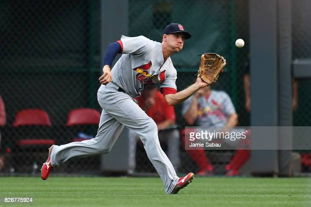 Stephen Piscotty of the St. Louis Cardinals makes a running catch of a short fly ball in right field to end the second inning against the Cincinnati...