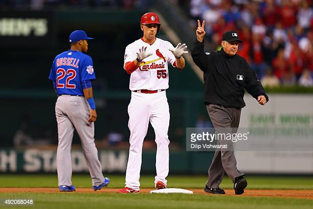 Stephen Piscotty of the St Louis Cardinals reacts after hitting a double in the first inning against the Chicago Cubs during game one of the National...