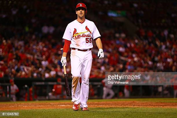 Stephen Piscotty of the St Louis Cardinals returns to the dugout after striking out against the Cincinnati Reds in the eighth inning at Busch Stadium...