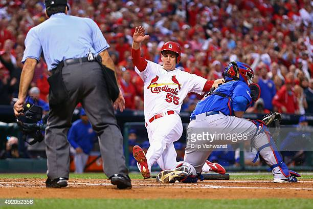 Stephen Piscotty of the St Louis Cardinals scores a run in the first inning against the Chicago Cubs during game one of the National League Division...