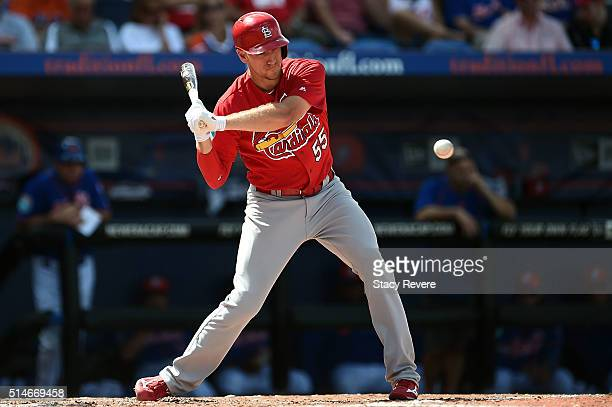 Stephen Piscotty of the St Louis Cardinals swings at a pitch during the fourth inning of a spring training game against the New York Mets at...