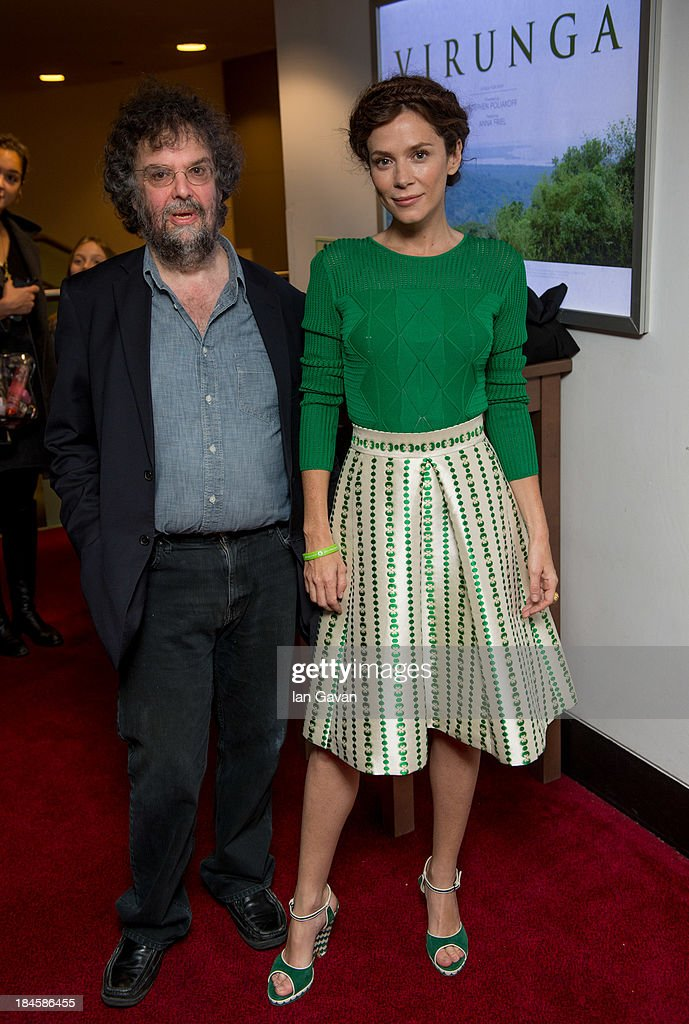Stephen Poliakoff and Anna Friel attend a screening of 'Virunga', a short film about Africa's oldest national park and its wildlife at BFI IMAX on October 14, 2013 in London, England.