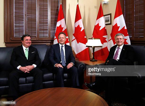 Stephen Poloz, governor of the Bank of Canada, center, is welcomed into office by Stephen Harper, Canada's prime minister, right, and Jim Flaherty,...