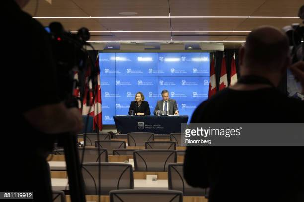Stephen Poloz governor of the Bank of Canada center right and Carolyn Wilkins senior deputy governor at the Bank of Canada prepare for a press...