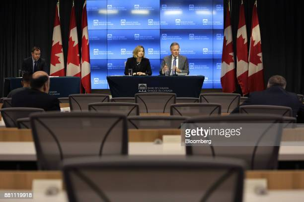 Stephen Poloz governor of the Bank of Canada center right speaks as Carolyn Wilkins senior deputy governor at the Bank of Canada listens during a...