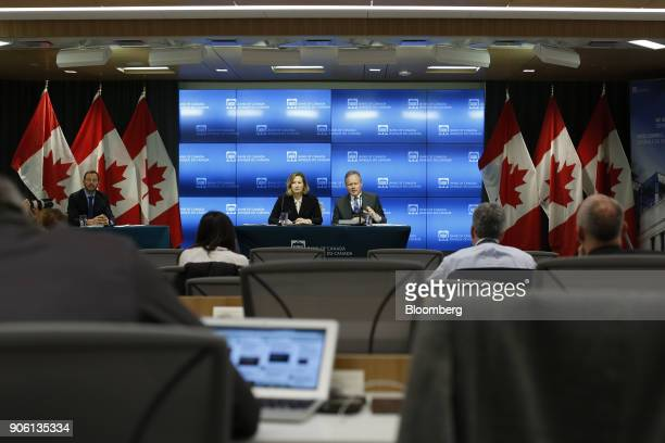 Stephen Poloz governor of the Bank of Canada center right speaks as Carolyn Wilkins senior deputy governor at the Bank of Canada center left listens...