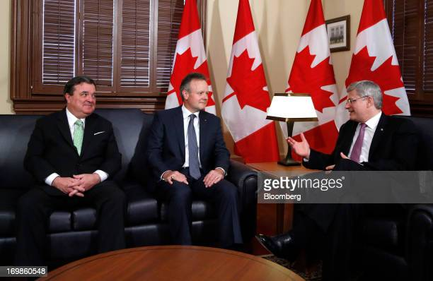 Stephen Poloz, governor of the Bank of Canada, center, speaks with Stephen Harper, Canada's prime minister, right, and Jim Flaherty, Canada's finance...