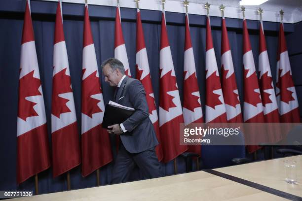 Stephen Poloz governor of the Bank of Canada exits after a news conference at the National Press Theatre in Ottawa Ontario Canada on Wednesday April...