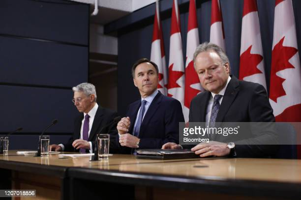 Stephen Poloz, governor of the Bank of Canada, from right, Bill Morneau, Canada's minister of finance, and Jeremy Rudin, head of the Office of the...