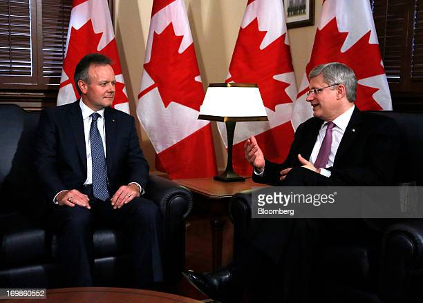 Stephen Poloz, governor of the Bank of Canada, left, speaks with by Stephen Harper, Canada's prime minister, while being welcomed into office in...