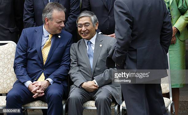 Stephen Poloz governor of the Bank of Canada left speaks with Haruhiko Kuroda governor of the Bank of Japan during a photo session ahead of the Group...