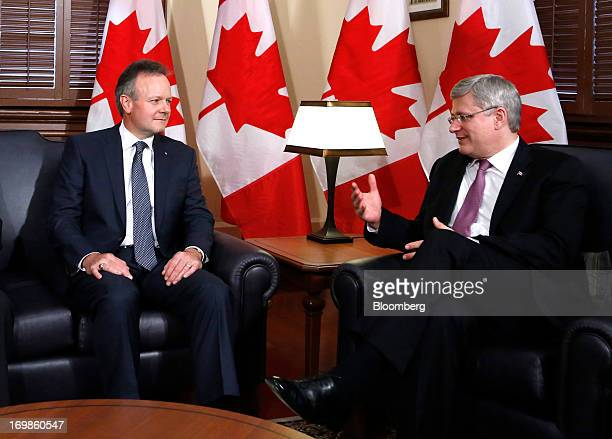 Stephen Poloz, governor of the Bank of Canada, left, speaks with Stephen Harper, Canada's prime minister, while being welcomed into office in Ottawa,...