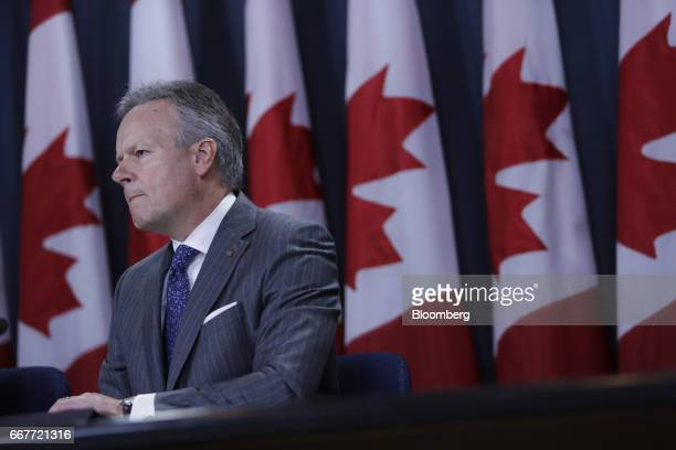 Stephen Poloz governor of the Bank of Canada listens during a news conference at the National Press Theatre in Ottawa Ontario Canada on Wednesday...
