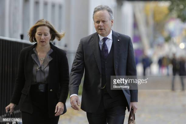 Stephen Poloz governor of the Bank of Canada right and Carolyn Wilkins senior deputy governor at the Bank of Canada arrive for a news conference at...