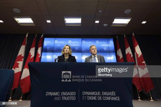 Stephen Poloz governor of the Bank of Canada right and Carolyn Wilkins senior deputy governor at the Bank of Canada listen during a press conference...