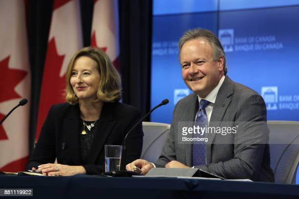 Stephen Poloz governor of the Bank of Canada right and Carolyn Wilkins senior deputy governor at the Bank of Canada smile during a press conference...