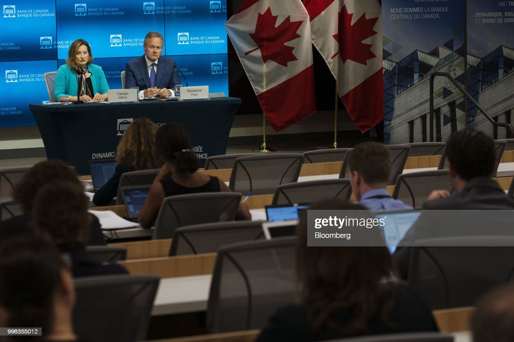 Stephen Poloz, governor of the Bank of Canada, right, and Carolyn Wilkins, senior deputy governor at the Bank of Canada, listen during a press conference in Ottawa, Ontario, Canada, on Wednesday, July 11, 2018. Polozbrushed aside concerns about trade wars and pressed ahead with a fresh interest rate increase as inflation hovers at its highest in seven years. Photographer: James Park/Bloomberg via Getty Images