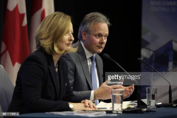 Stephen Poloz governor of the Bank of Canada right speaks as Carolyn Wilkins senior deputy governor at the Bank of Canada listens during a press...