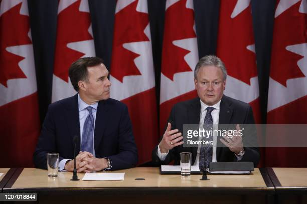 Stephen Poloz, governor of the Bank of Canada, right, speaks while Bill Morneau, Canada's minister of finance, listens during a news conference in...