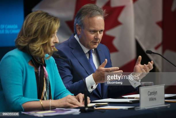 Stephen Poloz governor of the Bank of Canada right speaks while Carolyn Wilkins senior deputy governor at the Bank of Canada listens during a press...