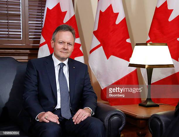 Stephen Poloz, governor of the Bank of Canada sits for a photograph while being welcomed into office by Stephen Harper, Canada's prime minister, not...