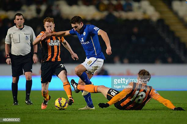 Stephen Quinn and Nikica Jelevic of Hull City tackle Matthew James of Leicester City uring the Barclays Premier League match between Hull City and...
