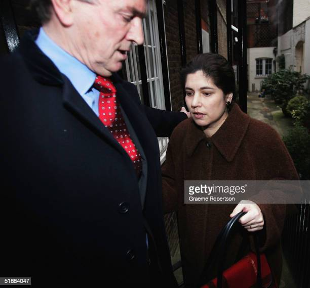 Stephen Quinn and wife Kimberly Quinn walk outside their home on December 21, 2004 in West London, England. Kimberley Quinn is the former lover of...