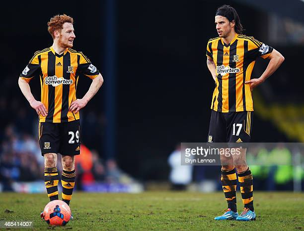 Stephen Quinn of Hull City AFC talks to team mate George Boyd during the FA Cup Fourth Round match between Southend United and Hull City at Roots...