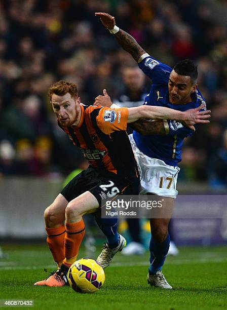 Stephen Quinn of Hull City and Danny Simpson of Leicester City battle for the ball during the Barclays Premier League match between Hull City and...