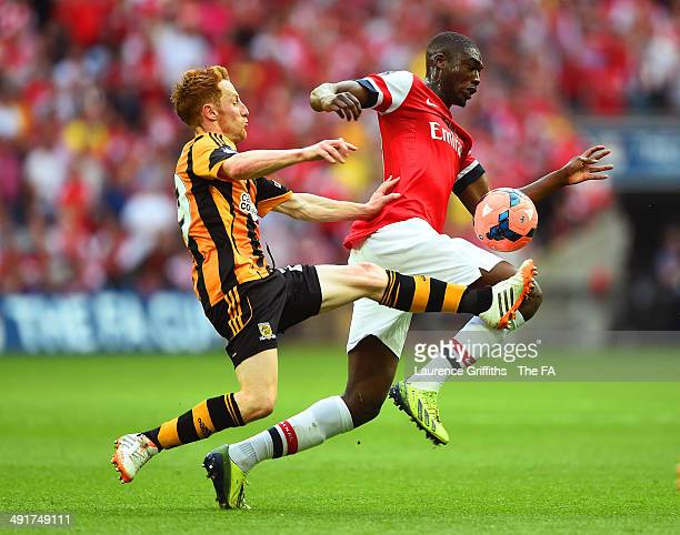 Stephen Quinn of Hull City challenges Yaya Sanogo of Arsenal during the FA Cup with Budweiser Final match between Arsenal and Hull City at Wembley...