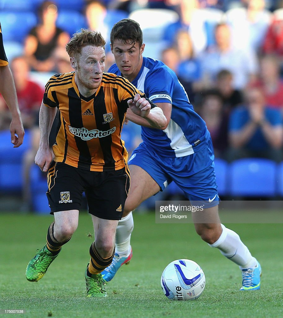 Stephen Quinn of Hull City moves away with the ball during the pre season friendly match between Peterborough United and Hull City at London Road Stadium on July 29, 2013 in Peterborough, England.