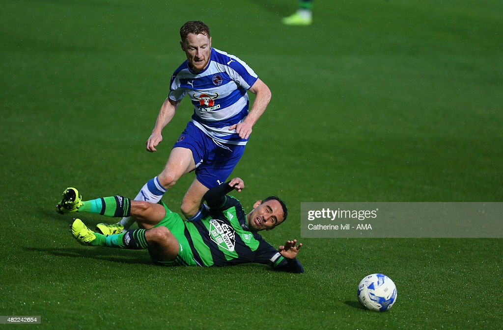 Stephen Quinn of Reading and Leon Britton of Swansea City during the pre-season friendly between Reading and Swansea City at Adams Park on July 24, 2015 in High Wycombe, England.