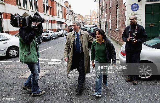 Stephen Quinn walks outside his home with the family nanny on November 29, 2004 in west London, England. Mr Quinn is the husband of Kimberly Quinn,...