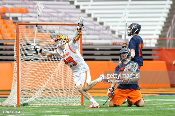 Stephen Rehfuss of the Syracuse Orange celebrates his goal on goalie Alex Rode of the Virginia Cavaliers during the second half at the Carrier Dome...