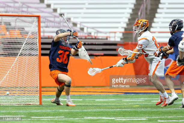 Stephen Rehfuss of the Syracuse Orange shoots the ball for a goal past goalie Alex Rode of the Virginia Cavaliers during the second half at the...