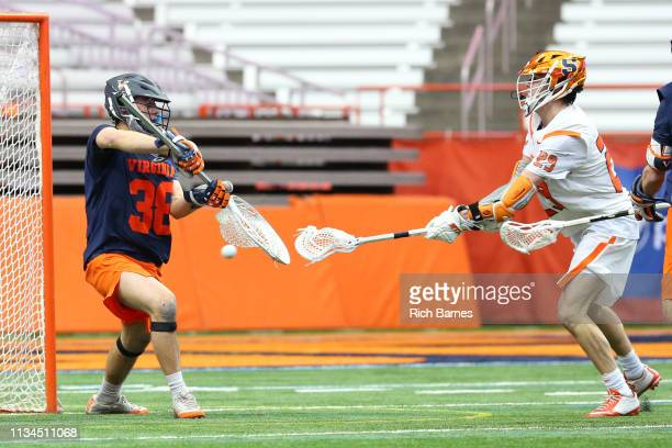 Stephen Rehfuss of the Syracuse Orange shoots the ball on goalie Alex Rode of the Virginia Cavaliers during the second half at the Carrier Dome on...