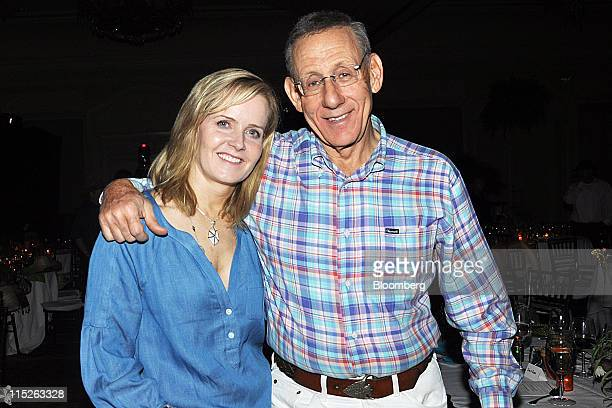 Stephen Ross chairman and chief executive officer of Related Cos LP right and his wife Kara Ross a jewelry designer stand for a photograph at the...