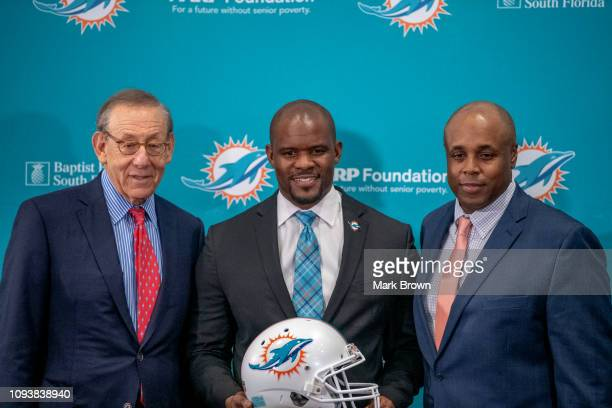 Stephen Ross Chairman Owner Brian Flores Head Coach Chris Grier General Manager of the Miami Dolphins pose for the media after announcing Brian...