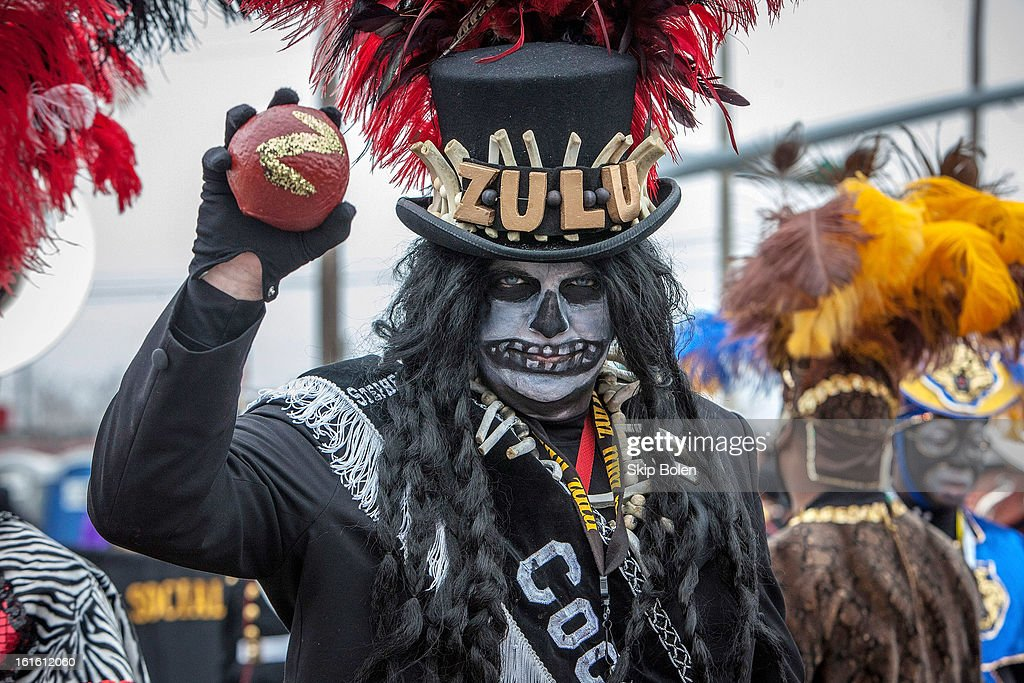 Stephen Rue holds up a hand-painted coconut, the most sought after throw in the Zulu Social Aid & Pleasure Club's 'Zulu Parade' on Jackson Avenue, the first parade on the morning of 2013 Mardi Gras on February 12, 2013 in New Orleans, Louisiana.