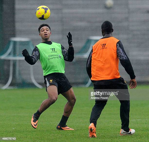 Stephen Sama and Jordon Ibe of Liverpool in action during a training session at Melwood Training Ground on January 31 2014 in Liverpool England