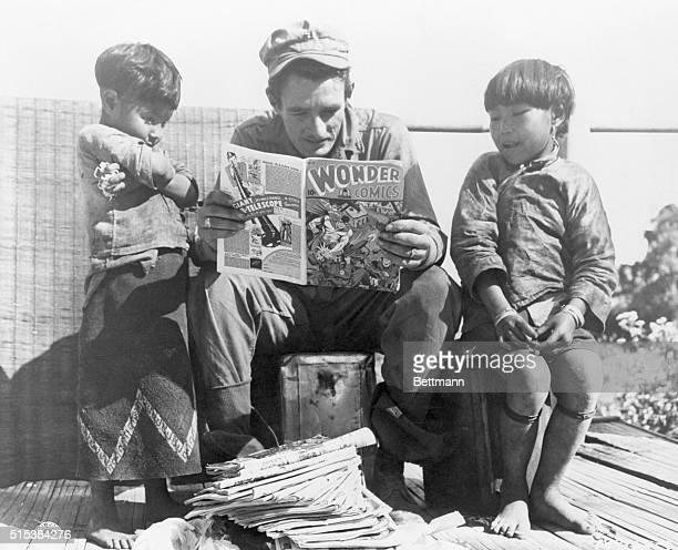 Stephen Schaeffer New York City becomes enchanted with his own story as he reads from a comic book to two hilldwelling Kachin youngsters A pile of...